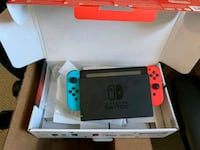 white and blue Nintendo Switch with box 41 km
