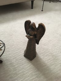 brown ceramic angel figurine