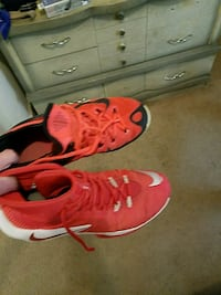pair of red Nike running shoes Rock Island, 61201