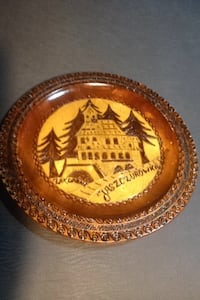 It's a church in the picture it was made in Poland that's what it says in the back carved  in Everett, 98201