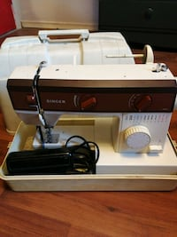 Singer Sewing Machine with extras Guelph, N1H 7W9