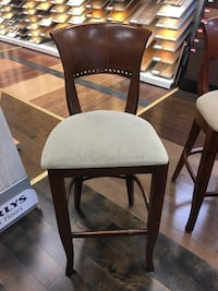 two black wooden framed white padded chairs Vaughan
