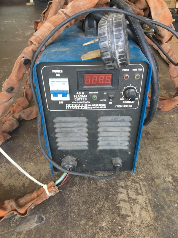 black and blue  Chicago Electric welding machine