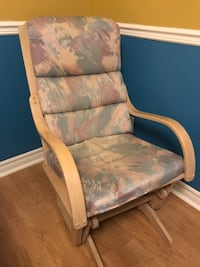 Rocking chair with cushion in a light wood stain in good condition Laval, H7W 5L9