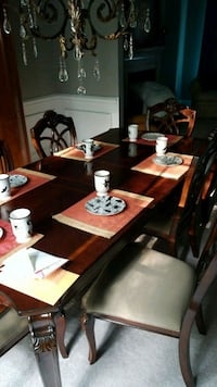 brown wooden dining table set with 6 chairs .  Davidson, 28036