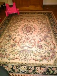 brown and red floral area rug Jacksonville, 32207