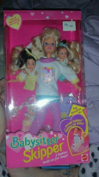 Barbie doll wearing pink dress box 463 km