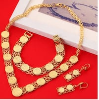 gold-colored necklace and bracelet