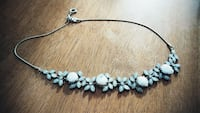 silver-colored and blue floral link necklace