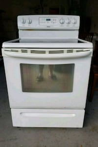white and black induction range oven 779 mi