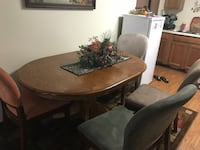 Oval brown wooden dining table with chairs West Des Moines, 50266