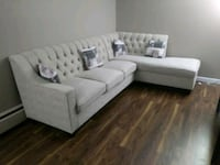 white fabric sectional sofa with throw pillows Surrey, V3R 1M8