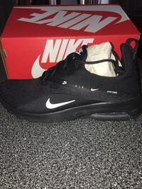 Black-and-white nike running shoes on box Whitby, L1P 1N6