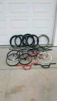 four assorted-color bike frames, tires, and rims