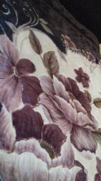 white, brown and black floral textile