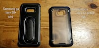 two black and gray smartphone cases