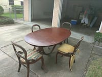 round brown wooden table with four chairs dining set Houston, 77047