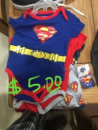 two Superman onesies