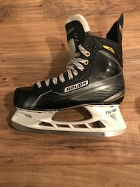 Pair of black bauer ice hockey skates