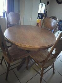 round brown wooden table with four chairs dining set Phoenix, 85040