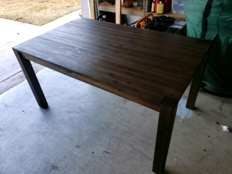 Photo Macy's Dark wood rustic style dining room table
