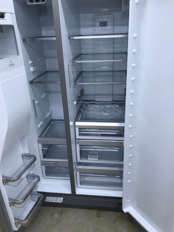 stainless steel side by side refrigerator with dispenser 2bc8ae0c-917d-4d66-b8ed-4d0093bda66d
