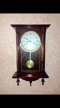 brown wooden pendulum wall clock Woodbury, 08096