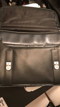 "Mcleins executive leather bag. Can fit up to 21"" laptop"