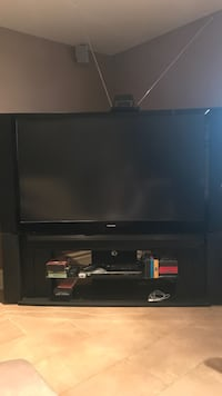 black flat screen TV with black wooden TV stand Laval, H7W 1S3