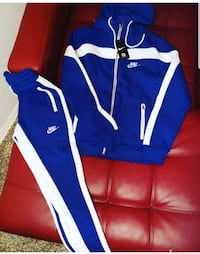 blue and white Adidas track pants Baltimore, 21215