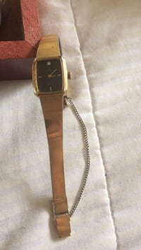 gold analog watch with gold link