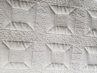 quilted white textile