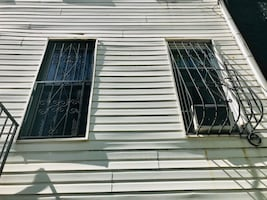 Free 2 Iron Window Bars...  Must be removed from the Windows.