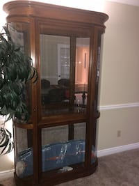 Brown wooden framed glass display cabinet Guelph, N1L 1B1