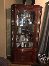 brown wooden framed glass display cabinet Lakewood, 80228