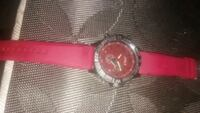 round silver chronograph watch with red leather strap Brooklyn, 11213