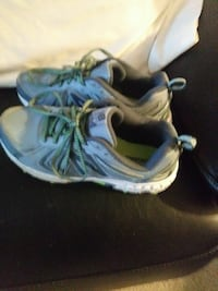 pair of grey and greenNew Balance running shoes