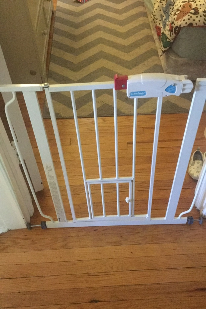 Photo Baby gate with small door for cats or small dog