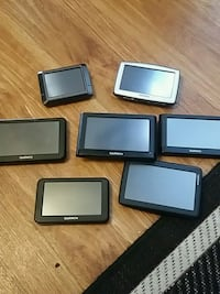 four black and one gray tablet computers London, N6H 4P3