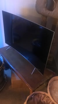 black flat screen TV with remote Los Angeles, 91325