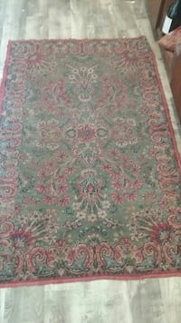 green, red, and white floral area rug