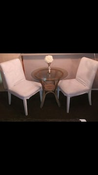 White chairs and glass outdoor table Los Angeles, 90063