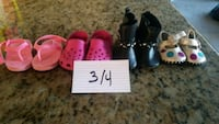 pair of black-and-pink slide sandals London