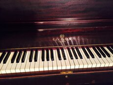 Brown wooden upright piano