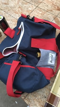 red and black Harschel duffel bag San Marcos, 92078