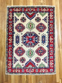 """Handmade 100% wool area rug. Clean, from a smoke free, pet free home. Size 46"""" x 33"""""""