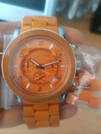 round gold Michael Kors chronograph watch with link bracelet St. Catharines, L2M