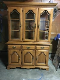 beige ornate wooden china cabinet