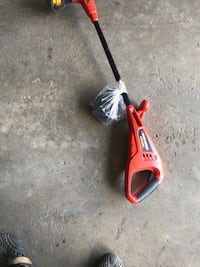 Red and black electric string trimmer Calgary, T3K 5T9