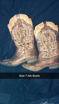 pair of size 7 brown leather cowboy boots